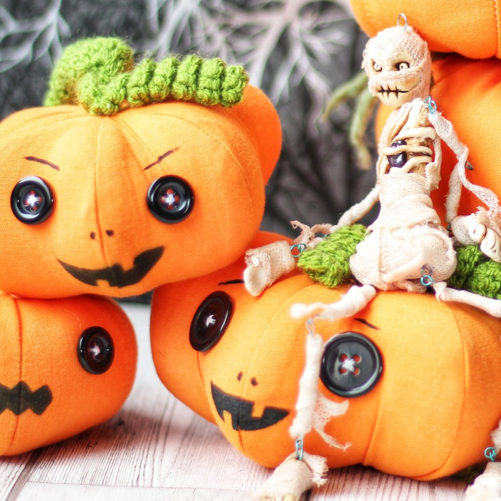 pumpkins and a mummy art doll