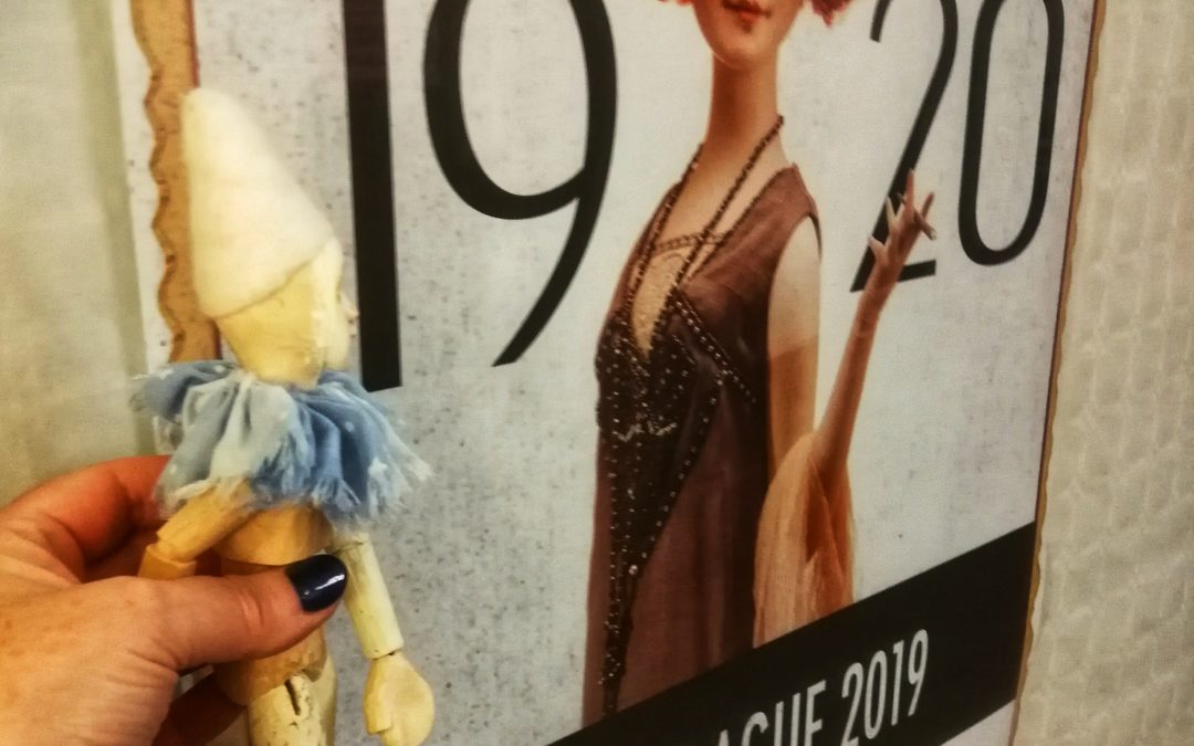 Maurice next to the Doll Prague poster