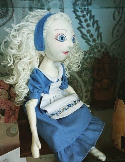 Alice sitting on a shelf