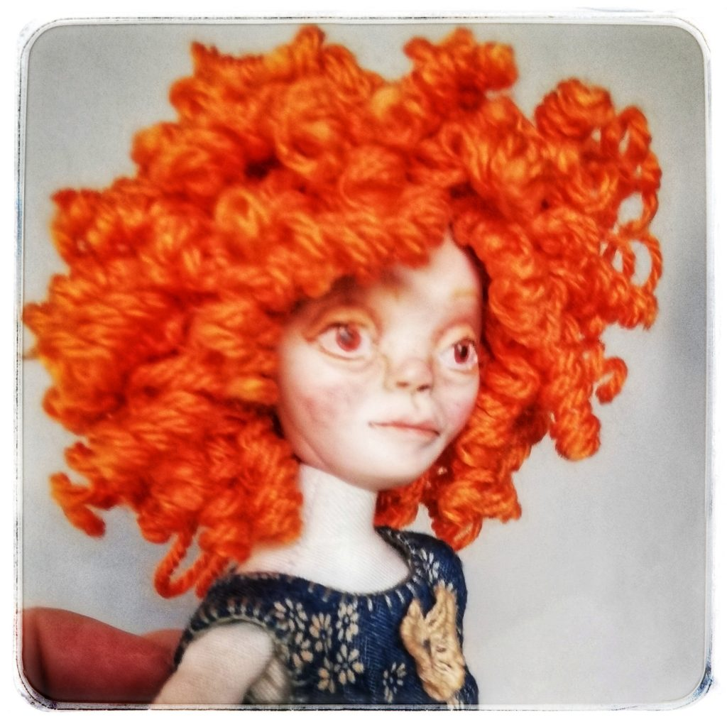 art doll with curly red hair