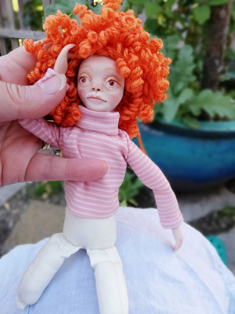 art doll with curly wig