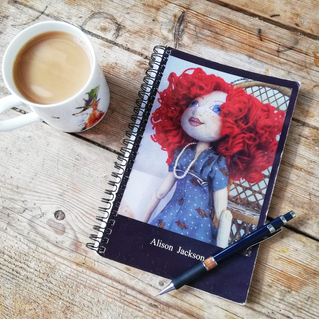 Notebook with Art Doll on cover