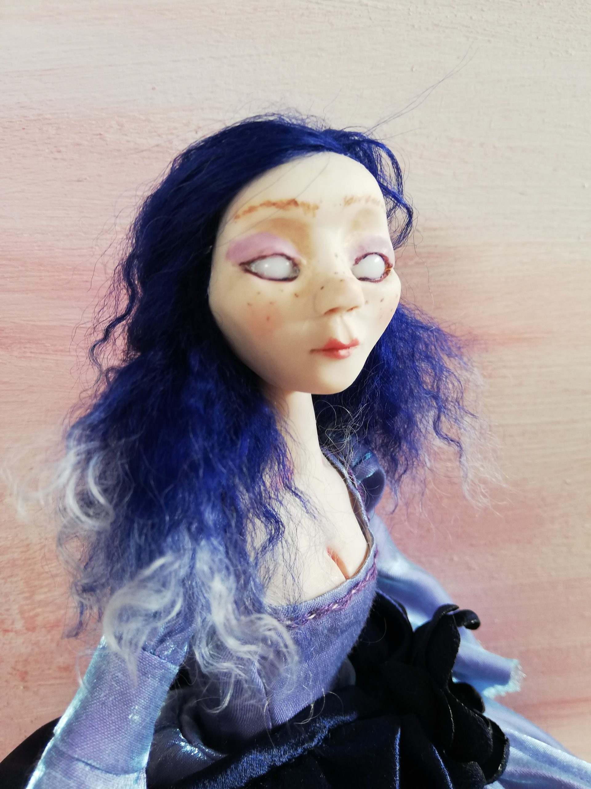 creepy art doll with ribbon joints